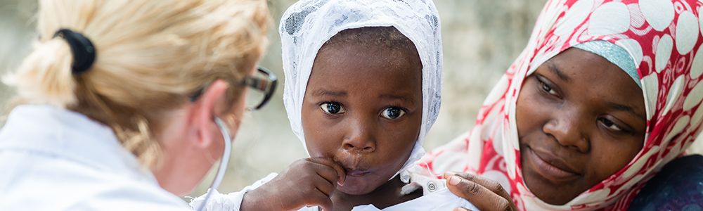 African child getting a check up by a doctor