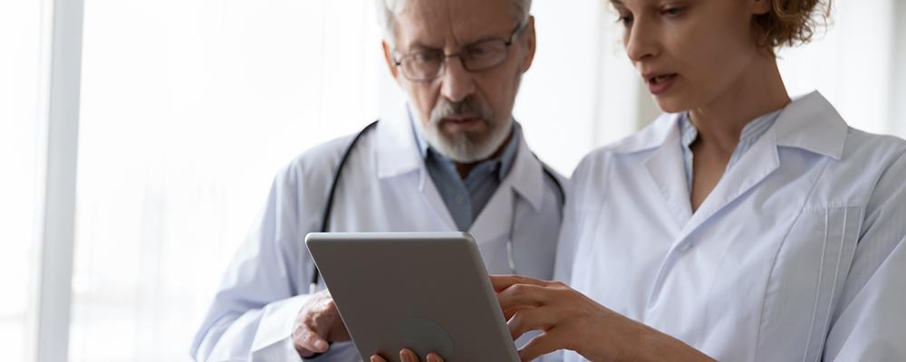 Doctors looking at an iPad