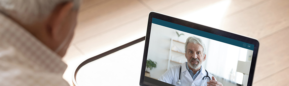 senior man in a virtual meeting with a doctor
